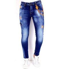 skinny jeans local fanatic broek verfspatten