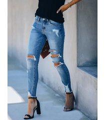 bolsillos laterales recortados detalles rotos al azar jeans