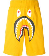 a bathing ape® shark wide track shorts - yellow