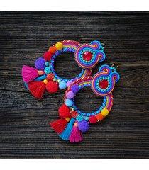 pulo- duże i etniczne kolczyki z pomponami