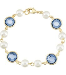 2028 gold-tone imitation pearl with dark blue channels link bracelet