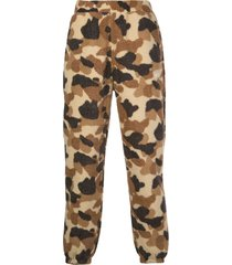 stussy camouflage fleece trousers - brown