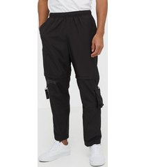 puma first mile 2in1 woven pant byxor black