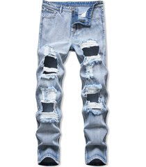 cut out destroyed acid wash tapered jeans