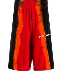 palm angels tie-dye print track shorts - red