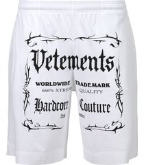 black label logo shorts white