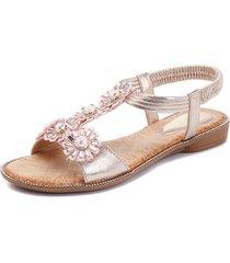 sandali piatti alla caviglia con cinturino alla boa di fiori bohemia