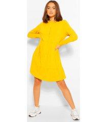 gesmokte jurk met knopen, lange mouwen en laagjes, mustard