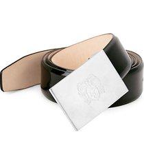 crest engraved patent leather belt