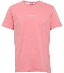 instit chest logo re t-shirts short-sleeved rosa calvin klein jeans
