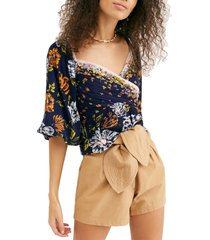 women's free people mirabella floral wrap front blouse, size x-small - blue