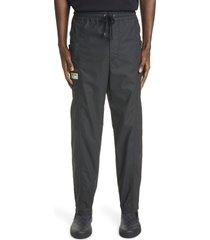 men's gucci logo label coated cotton drawstring pants, size 30 us/ 46 eu - black