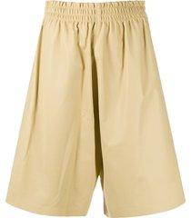 bottega veneta knee-length leather shorts - yellow
