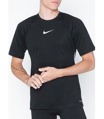 nike m nk aeroadpt top ss npc tränings t-shirts svart