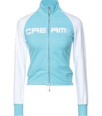 cream upper level sweatshirts