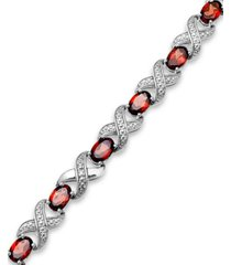 garnet (7-1/2 ct. t.w.) and diamond accent xo bracelet in sterling silver