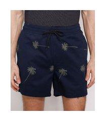 short de sarja masculino estampado de coqueiros com recorte e bolsos azul marinho
