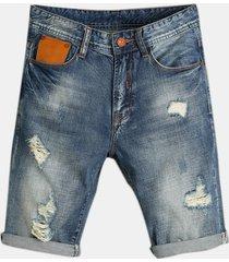 jeans per uomo con fori sottili sciolti retro biker strappati corti