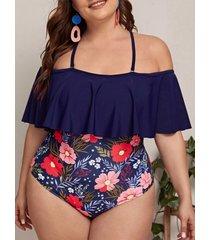 traje de baño de manga corta con estampado floral azul marino y hombros descubiertos