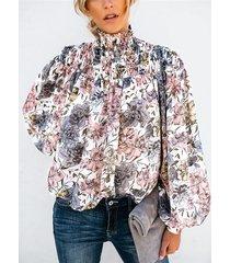 blusa de manga larga con estampado floral alto cuello blanco