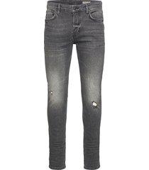 cigarette damaged slimmade jeans svart allsaints