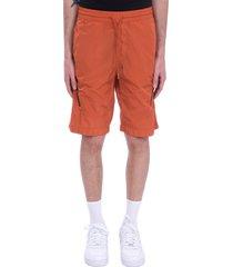 c.p. company shorts in orange synthetic fibers