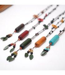 collana di gioielli etnici collana in legno d'epoca pendente in pelle fiore nappa per le donne
