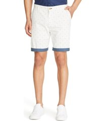 "tallia men's slim-fit star print 9"" shorts"