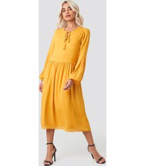 trendyol tasseled midi dress - yellow