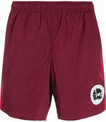 alexander mcqueen skull patch swim shorts - red
