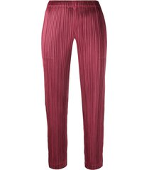 pleats please issey miyake micro pleated trousers - red