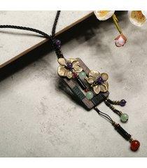 collana con pendente di legno gioielli
