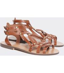 motivi sandali bassi alla schiava donna marrone