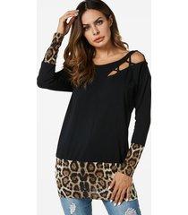 camisetas negras con costuras de leopardo recortadas