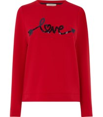 love sweater met lovertjes
