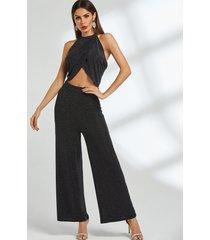 conjunto de pantalón de pernera ancha y top halter con diseño cruzado en negro