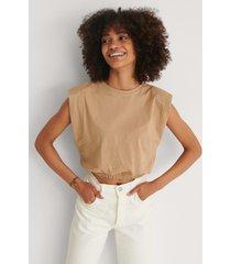 trendyol t-shirt med axelvaddar - beige