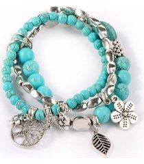 braccialetto in perline turchese blu bouclé con perline a forma di fiore