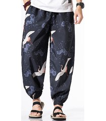 hombres estilo chino flying crane all over print casual pantalones