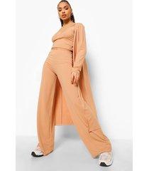 geribbelde bralette, duster jas en wide leg broek, camel