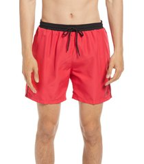 boss starfish solid swim trunks, size large in medium pink at nordstrom