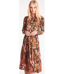 pomarańczowa sukienka z długim rękawem z wężowym wzorem