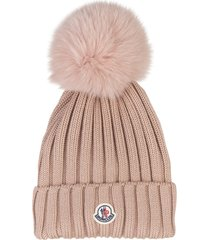 woman light pink hat with fox pompon