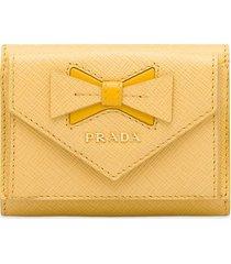 prada bow-embellished saffiano wallet - yellow