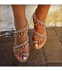 sandalias planas de mano perlas romanas
