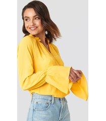 na-kd boho deep v-neck flare cuff blouse - yellow