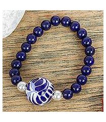 ceramic and lapis lazuli pendant stretch bracelet, 'cobalt flourish' (mexico)