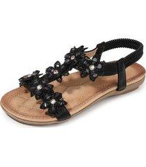 las sandalias de mujer son cómodas y de color negro suave.