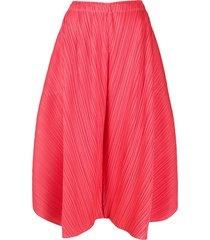 pleats please issey miyake micro-pleated wide leg trousers - orange