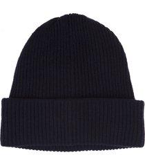 woman dark blue round beanie hat